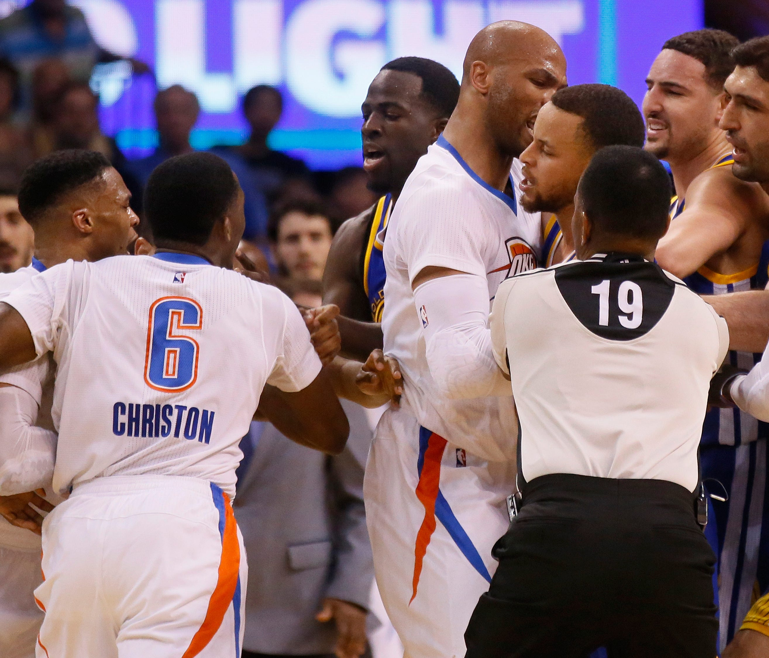 From left, Oklahoma City Thunder guard Russell Westbrook and guard Semaj Christon (6), Golden State Warriors forward Draymond Green, Thunder forward Taj Gibson, and Warriors guards Stephen Curry and Klay Thompson get into a tussle during the second q