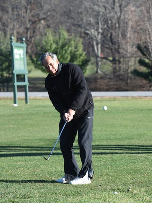 Carlo Marras of Pleasant Valley practices his chip shot at James Baird State Park in Pleasant Valley on Monday. Marras has been able to stretch his golfing season much further than usual due to the warm weather we have been having through November.