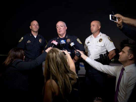 Port St. Lucie Police Chief John Bolduc (center) speaks to news media about the fatal police-involved shooting Friday, Nov. 18, 2016, at a home on the 600 block of Southwest Colleen Avenue in Port St. Lucie. Bolduc said the incident is being investigated by the Florida Department of Law Enforcement.CQ: John Bolduc