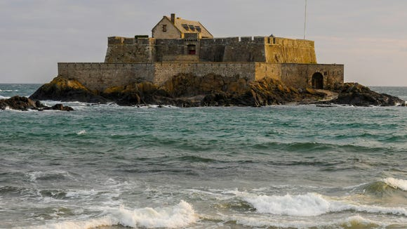 St. Malo's historic prison island at high tide.