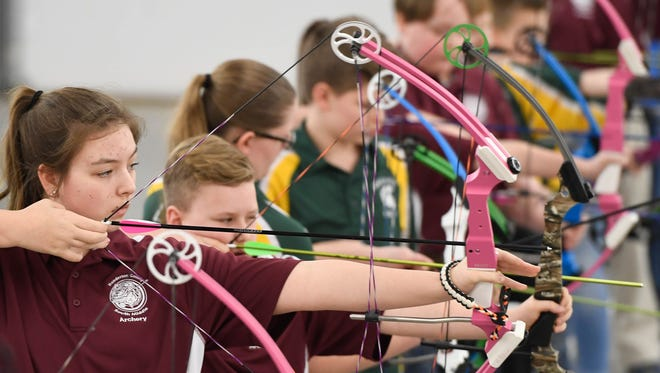 South Middle School student Kendall Pullum (left) takes aim as she shoots in the National Archery in the Schools Program Second Region Tournament Thursday. The three-day tournament features 816 archers from 38 schools ages 4th grade to high school from across Western Kentucky.