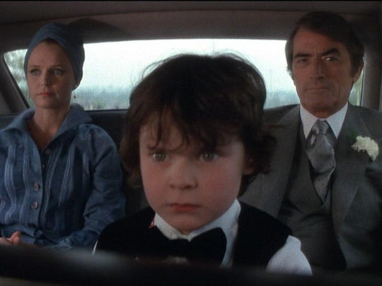 "Lee Remick and Gregory Peck raise the devil's child (Harvey Spencer Stephens) in 1976's ""The Omen."""