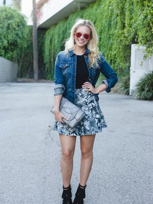Cassie McConnell Kelley, Nashville fashion blogger and wife of Lady Antebellum's Charles Kelley, wears a denim jacket from J. Brand, cropped tee from Alice & Olivia, print skirt from BCBG and fringed booties from Jeffrey Campbell.