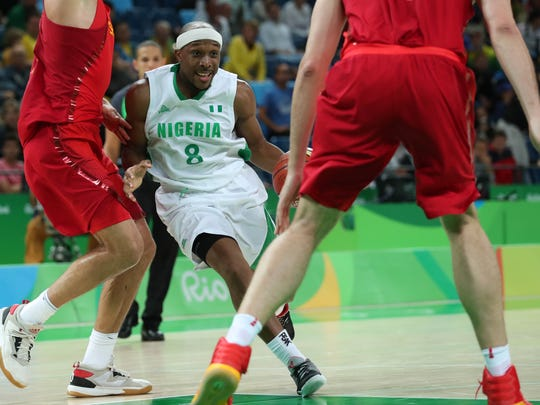 Aug 11, 2016; Rio de Janeiro, Brazil;  Nigeria guard Josh Akognon (8) works around Spain defense during the men's preliminary round in the Rio 2016 Summer Olympic Games at Carioca Arena 1.