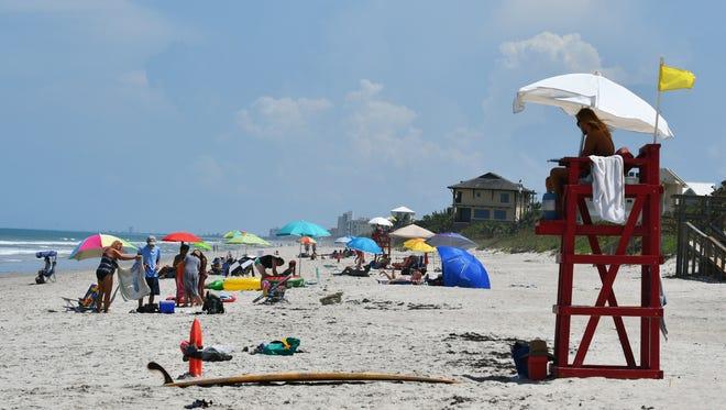 A lifeguard watches beach-goers at Pelican Beach Park in Satellite Beach.