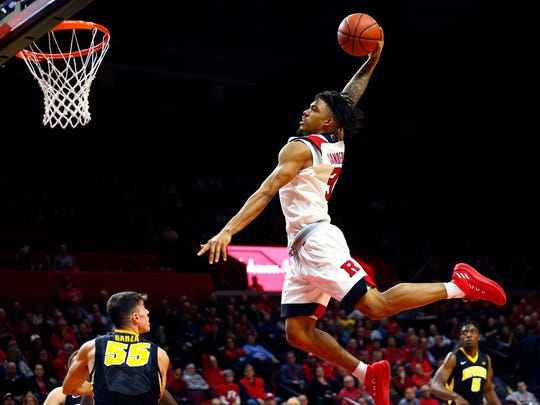 Rutgers Scarlet Knights guard Corey Sanders (3) dunks against Iowa Hawkeyes forward Luka Garza