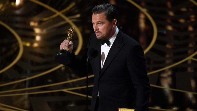 Leonardo DiCaprio accepts the best actor Oscar for 'The Revenant' Sunday in Los Angeles.