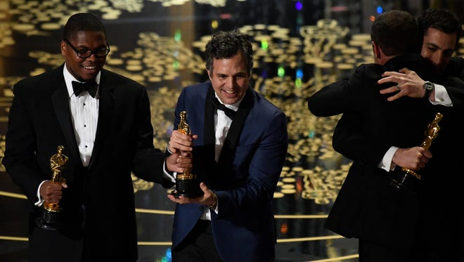 Mark Ruffalo celebrates with 'Spotlight' cast members as they  accept the Oscar for Best Picture for 'Spotlight'   during the 88th annual Academy Awards at the Dolby Theatre.