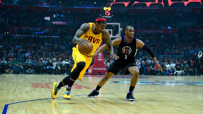 Cleveland Cavaliers guard Iman Shumpert (4) drives against LA Clippers guard Chris Paul (3) during the first half of a NBA game at the Staples Center.