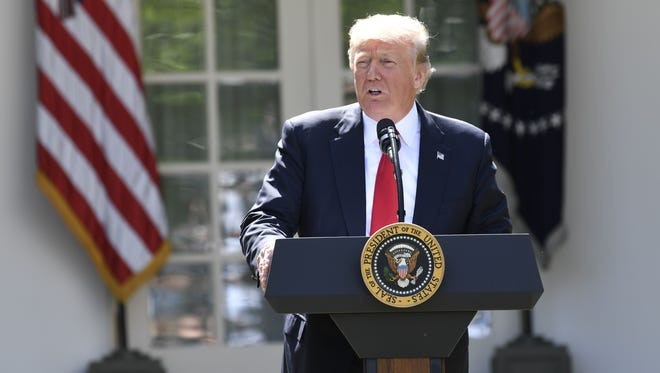 President Trump announces his decision on the Paris climate agreement in the Rose Garden of the White House on June 1, 2017.