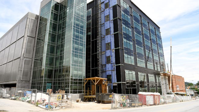 The Buncombe County Health and Human Services building on Coxe Avenue is being expanded with additions to the building and a parking deck.