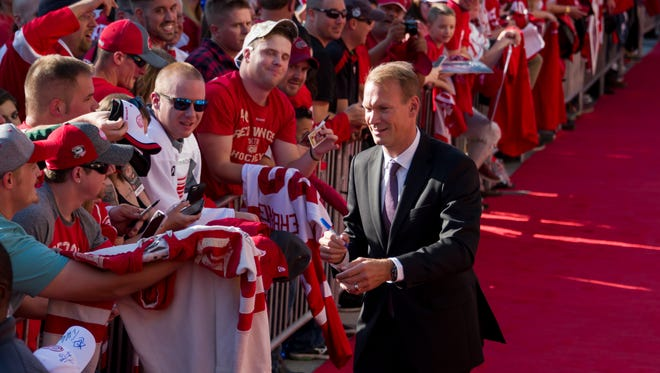 Former Red Wings captain Nicklas Lidstrom walks down the red carpet as he arrives at Little Caesars Arena Thursday.