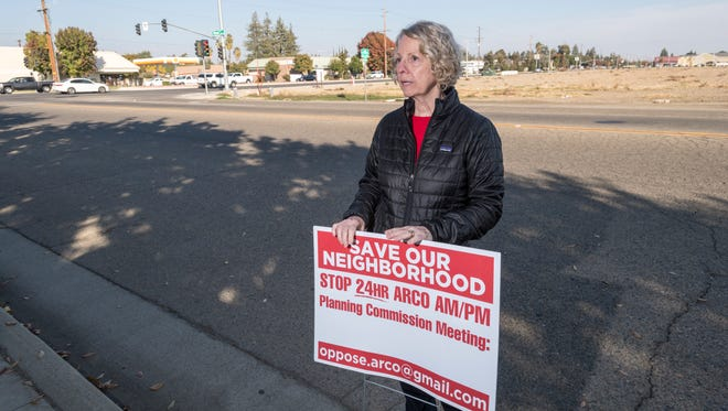 Robin Hernandez leads a groups of residents opposing the construction of a new gas station proposed for the southeast corner of Caldwell Avenue and West Street. Photo taken on Monday, November 13, 2017.