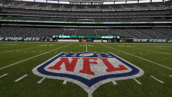 General overall view of the NFL Shield logo at midfield at MetLife Stadium during an NFL football game between the Los Angeles Chargers and the New YorK Jets.