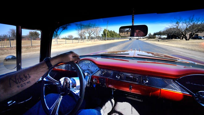Jack Young drives down Industrial Boulevard in a 1955 Chevrolet Bel Air 210 owned by Maxey Chittum Wednesday. The classic car recently made the cover of this year's Snap-on Tools calendar.