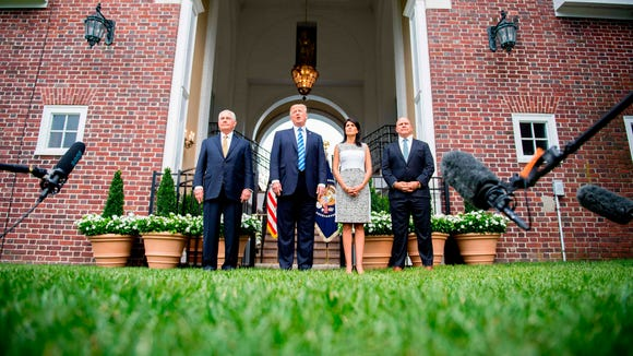 President Trump, center, speaks to the press with Secretary of State Rex Tillerson, left, United Nations Ambassador, Nikki Haley, second from the right, and National Security Adviser H. R. McMaster, right, on Aug. 11, 2017, at Trump National Golf Club in Bedminster, N.J.