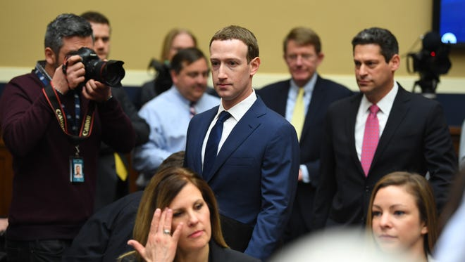 Facebook CEO Mark Zuckerberg enters the hearing room on Capital Hill as he arrives to testify before the House Energy and Commerce Committee on April 11, 2018. A new survey from Pew Research Center found that most Americans think it likely that social media platforms censor political viewpoints.