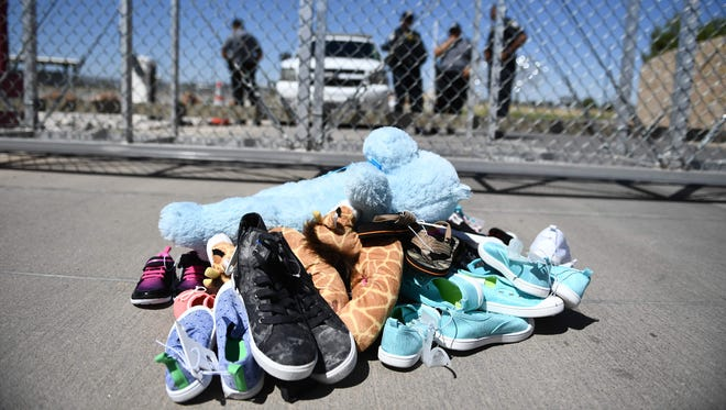 Shoes are left by people at the Tornillo Port of Entry near El Paso, Texas, June 21, 2018 during a protest rally by several American mayors against the US administration's family separation policy.