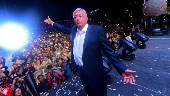 """Newly elected Mexico's President Andres Manuel Lopez Obrador, running for """"Juntos haremos historia"""" party, cheers his supporters at the Zocalo Square after winning general elections, in Mexico City, on July 1, 2018."""