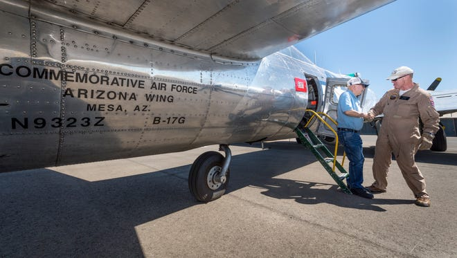 """Flight Load Master David Gilham, right, helps Howard Hildebrand exit the B-17 Bomber """"Sentimental Journey"""" after his flight on Monday, September 10, 2018. The B-17G, one of eight still flying today, will be on display at the Visalia Airport through Sunday."""