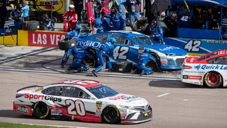 Kyle Larson makes a pit stop during the Pennzoil 400 at Las Vegas Motor Speedway.