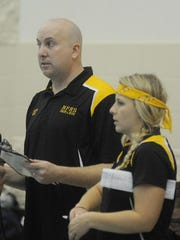 Coaches Mike Harfoot and Chrissy Fleck keep track of