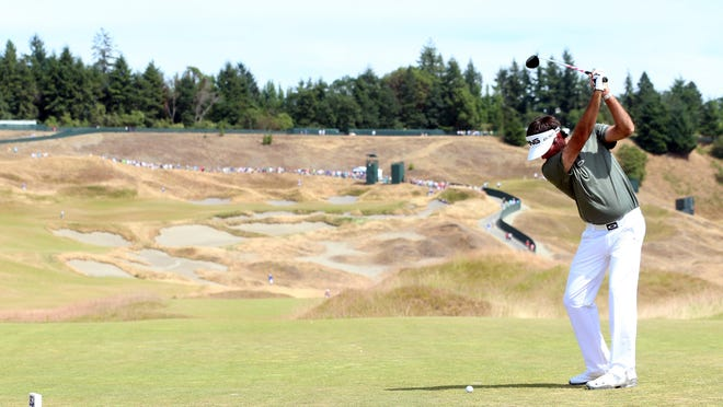 Bubba Watson hits a tee shot during a practice round prior to the start of the 115th U.S. Open Championship at Chambers Bay.