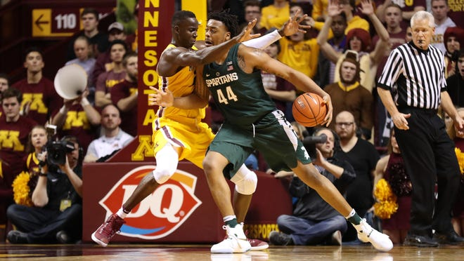 Michigan State's forward Nick Ward (44) got Bakary Konate and Minnesota's big men in foul trouble during the Spartans' 75-74 overtime win in Minneapolis on Dec. 27.