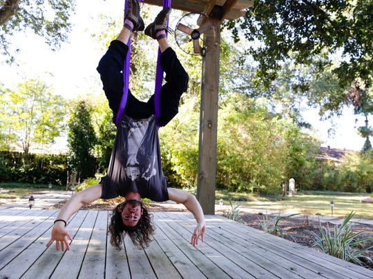 Jared Roy hangs up upside down  a yoga class incorporating hanging silksOct. 29, 2016 at Yoga Garden in Lafayette.