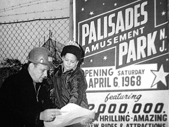 A publicity photo of John Rinaldi, Palisades Amusement Park's superintendent and general manager, with his son John Rinaldi Jr., looking over plans for the park in the spring of 1968.
