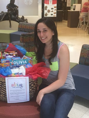 Olivia Vogel is collecting coloring books and crayons.