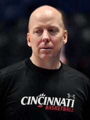 Cincinnati head coach Mick Cronin watches his team
