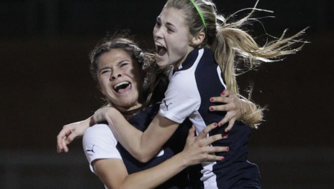 At far right, La Quinta High School  Kailee Prescott  embraces Jianna Guerrero after Guerrero scores her team's third goal to take the lead 3-1 in the second half of the game against Palm Desert High School at Palm Desert on February 11, 2016. La Quinta won the game 3-1 for the DVL title.