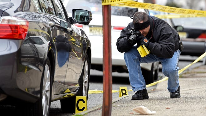 A member of the Paterson Police Crime Scene Unit investigating the January shooting in Paterson for which Dahmir Bethea of Clifton was arrested.