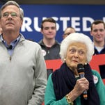 Barbara Bush, right, mother of Republican presidential candidate, former Florida Gov. Jeb Bush, left, introduces her son at a town hall meeting at West Running Brook Middle School in Derry, N.H., Thursday Feb. 4, 2016. (AP Photo/Jacquelyn Martin)