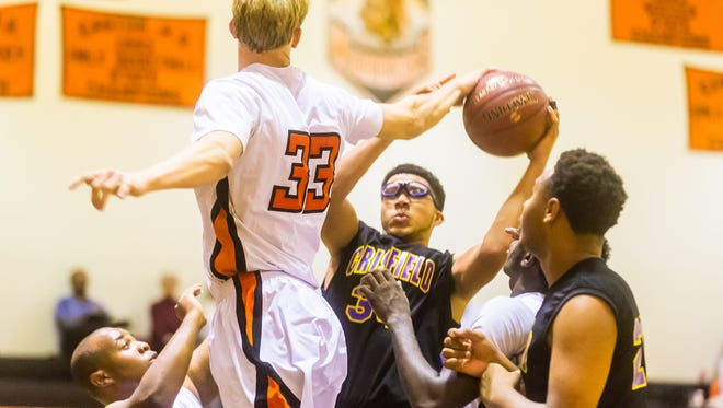 Crisfield forward Trajuan Sterling (34) has his shot blocked by Warriors forward Ryan Hall (33) against Easton on Friday, December 4th at Easton High.