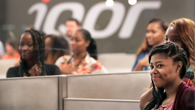 iQor employees in the customer support call center in Memphis. The company has announced 100 temporary workers and 31 direct employees will be laid off from the Memphis office.