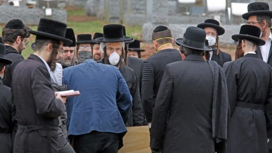 People gather to attend the burial of Josef Neumann at Viznitz Cemetery in Spring Valley March 30, 2020. Neumann, 72, died from his injuries suffered in the Monsey Hanukkah machete attack.