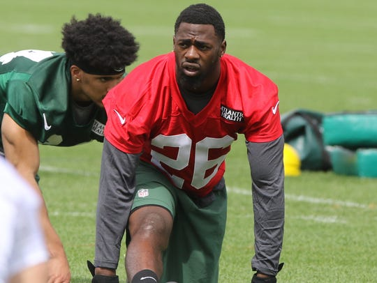 Second round draft pick Marcus Maye loosens up before