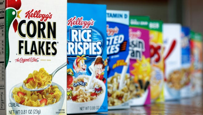 """FILE - This Feb. 1, 2012, file photo, shows Kellogg's cereal products, in Orlando, Fla. On its website, amid news of Pop-Tarts and Frosted Flakes, Kellogg touted a distinguished-sounding """"breakfast council"""" of """"independent experts"""" dedicated to guiding its nutritional efforts. Nowhere did it say that Kellogg paid the council members and spoon-fed them talking points about the benefits of cereal and breakfast, according to a copy of a contract and email exchanges obtained by The Associated Press. (AP Photo/John Raoux, File)"""