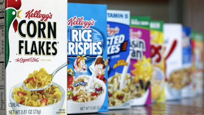 FILE - This Wednesday, Feb. 1, 2012 file photo, shows Kellogg's cereal products, in Orlando, Fla.  Cereal maker Kellogg Co. Kellogg Co. on Monday, April 23, 2012 cut its 2012 forecast because of slower sales growth in its first quarter. Its stock slid $3.14, or 5.8 percent, to $50.85 in premarket trading. Kellogg said that it now expects a full-year profit between $3.18 and $3.30 per share because of the weaker sales growth in Europe and for some U.S. products in the first three months of the year.  (AP Photo/John Raoux, File)