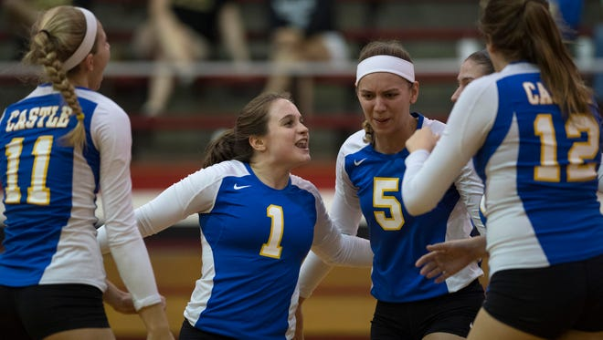 Castle's Jessica Nunge (5) and Annie Purdue (1) gather with teammates during the sectional semifinal against North at Harrison High School. Nunge was voted the All-Metro Player of the Year.