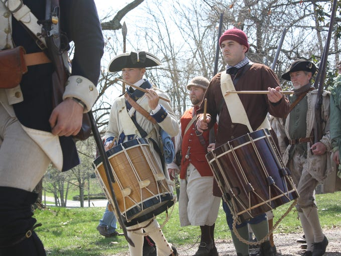 Members of the Illinois Regiment Revolutionary War reenactment group, along with a group of county militia, march on the grounds of Locust Grove during the 22nd annual â??18th Century Thunderâ? in celebration of George Rogers Clark on Saturday.  (By Jenna Esarey, special to The Courier-Journal)  April 12, 2014.