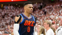 Russell Westbrook heads to the bench after being assessed