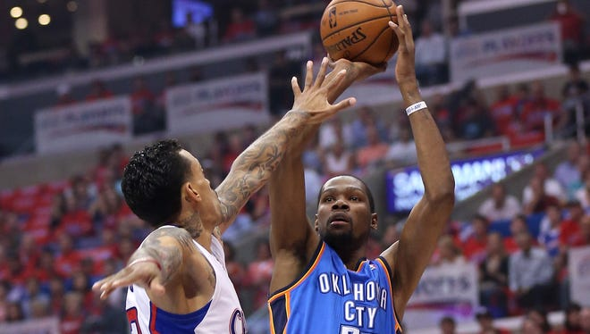 Oklahoma City's Kevin Durant shoots over the Clippers' Matt Barnes in Game 6 of the Western Conference Semifinals during the 2014 NBA Playoffs at Staples Center on May 15, 2014.