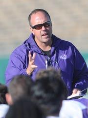 First-year ACU coach Adam Dorrel talks to his team