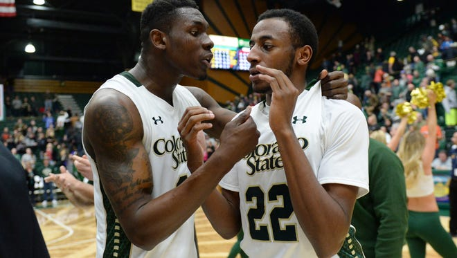 CSU basketball player Emmanuel Omogbo, left, celebrates with teammate J.D. Paige after a Jan. 6 win over UNLV at Moby Arena. Omogbo is expected to return to CSU on Tuesday following a trip home to grieve with family members following the death of his parents and his sister's 2-year-old twins in a house fire last week in suburban Washington, D.C.