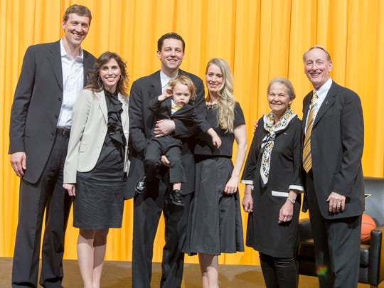 Bryce Drew, center, attends his introductory press conference as Vanderbilt's new basketball coach in April. His family, left to right, includes brother-in-law Casey Shaw, sister Dana Shaw, son Bryson, wife Tara, and parents Janet and Homer Drew.