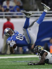 Eric Ebron is tackled by Jaguars safety Tashaun Gipson