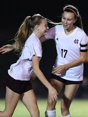 Henderson's Hannah Jones (17) congratulates teammate